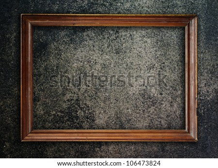 Old picture frame on wall to put your own pictures in.