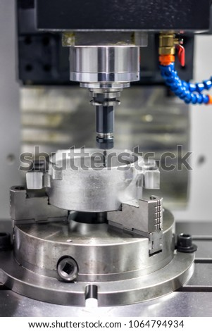 High precision CNC machining center working, operator machining automotive sample part process in factory #1064794934