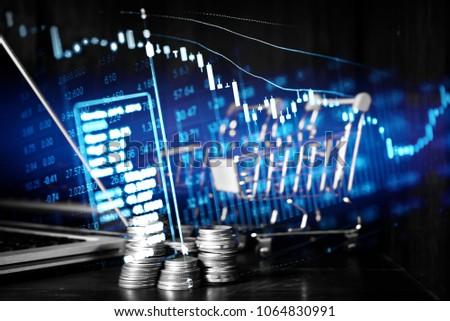 Charts of financial instruments with various type of indicators including volume analysis for professional technical analysis on the monitor of a computer. Fundamental and technical analysis concept. #1064830991
