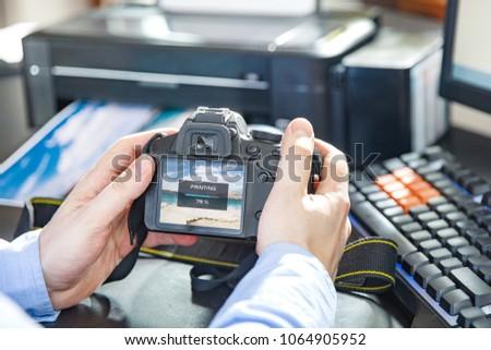 Businessman sends a photo to wireless printer by camera #1064905952