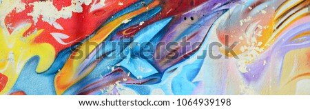 Abstract graffiti paintings on the concrete wall. Background texture Royalty-Free Stock Photo #1064939198
