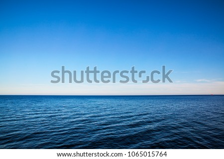 Seascape with sea horizon and almost clear deep blue sky - Background #1065015764