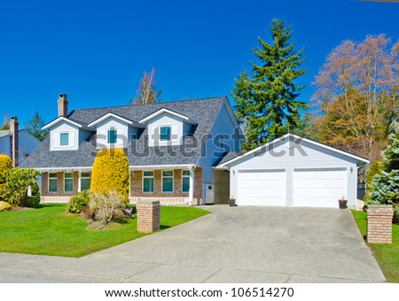 Custom built big luxury house with double doors garage in a residential neighborhood. Suburbs of Vancouver ( Surrey ) Canada. #106514270