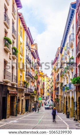 PAMPLONA, SPAIN, OCTOBER 28, 2014: People are strolling on a street in Pamplona, Spain