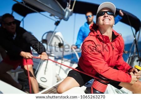 Attractive strong woman sailing with her boat Royalty-Free Stock Photo #1065263270