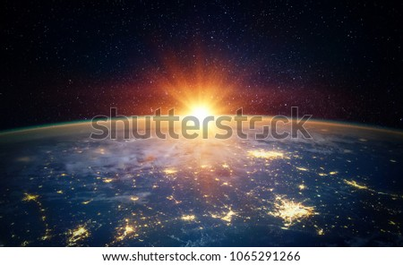 Earth, sun, star and galaxy. Sunrise over planet Earth, view from space. Elements of this image furnished by NASA Royalty-Free Stock Photo #1065291266