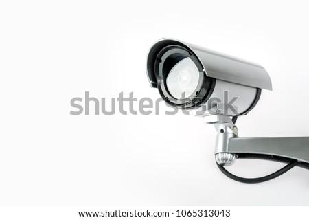 CCTV camera isolated on white background. #1065313043