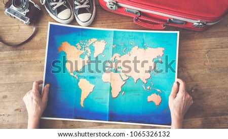 Woman holding map travel concepts #1065326132