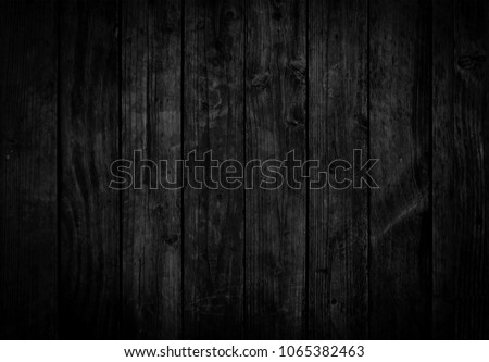 Black wood texture background coming from natural tree. Dark black Wooden panel with beautiful patterns. Space for work #1065382463