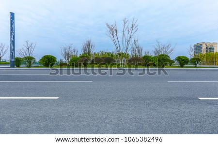 Clean unmanned expansive square path and park trees in the city #1065382496