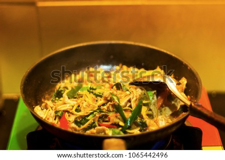 Fried herbal vegetables with fish, squid etc in the pan with kaffir lime leaves pepper #1065442496