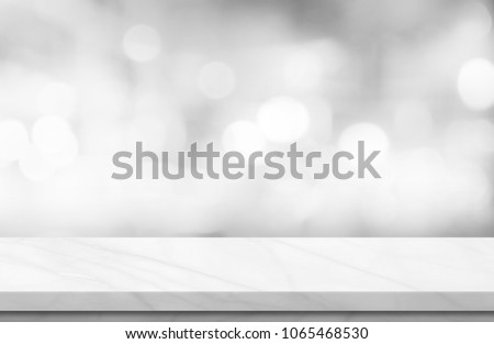 Empty white marble over blur background, for your photo montage or product display, Space for placing items on the table, product and food display. #1065468530