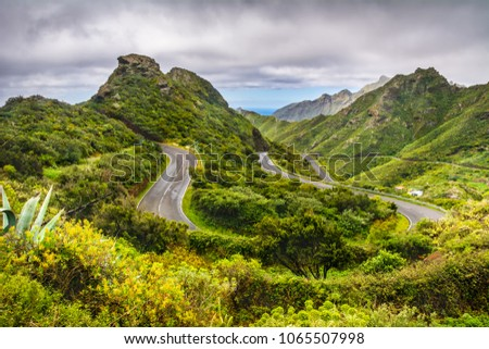 Mountain serpentine. The road is mountainous. The way from Anaga to Santa Cruz de Tenerife. Stunning top view. Anaga, Tenerife, Canary Islands, Spain. #1065507998