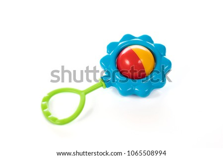 Baby rattle in the shape of a flower on a white background #1065508994