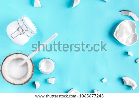 concept organic cosmetics with coconut on blue background top vi #1065677243
