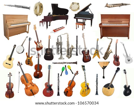 Different music instruments under the white background Royalty-Free Stock Photo #106570034