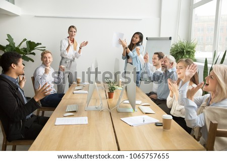 Corporate diverse team colleagues congratulating motivated african coworker with business success or achievement clapping hands in coworking office, multiracial employees applaud excited by good news #1065757655