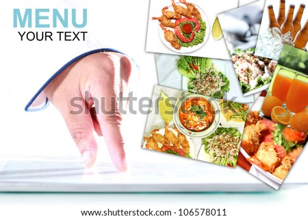 Chef is using a digital tablet, With a pictures Food items