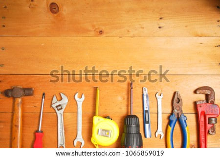 Assorted work and home tools.Wooden background and copy space #1065859019
