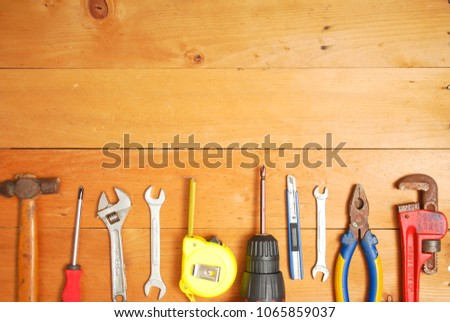 Assorted work and home tools.Wooden background and copy space #1065859037