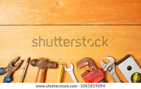 Assorted work and home tools.Wooden background and copy space #1065859094