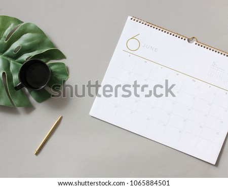 Scheduling agenda of month June on table calendar #1065884501