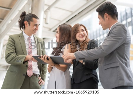 In selective focus of people Sharing and discussing ideas at outdoor meeting.Businessman and businesswoman working outdoor. #1065929105