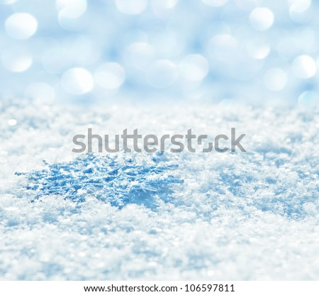 Winter background. Snowflakes on snow