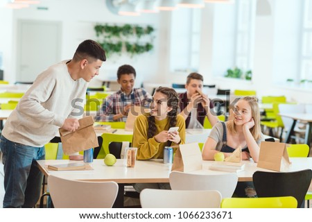 high school students at school cafeteria Royalty-Free Stock Photo #1066233671