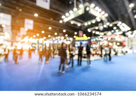 Abstract blurred defocused trade event exhibition background, business convention show concept. Royalty-Free Stock Photo #1066234574