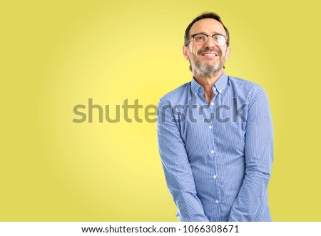 Handsome middle age man confident and happy with a big natural smile laughing looking up #1066308671
