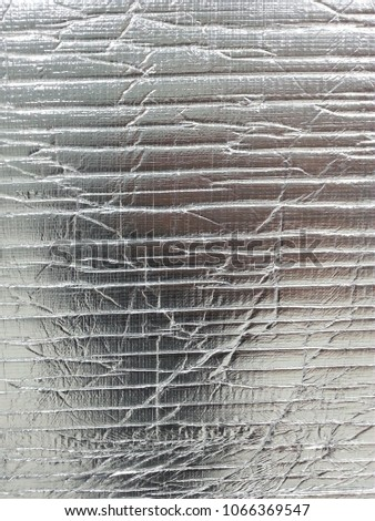 Silver background uneven and glossy #1066369547