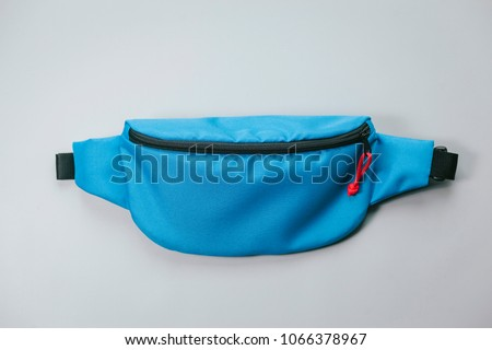 Waist bag of banana of blue colour on a white background isolation Royalty-Free Stock Photo #1066378967
