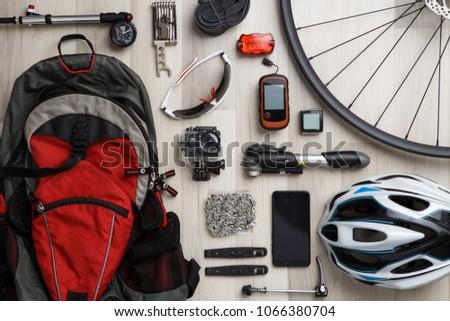 Wheel, steering wheel, seat, helmet, tire, sunglasses, reflective tape, backpack.