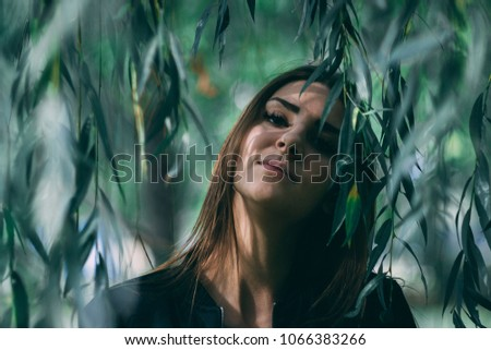 Portrait of a girl in the nature #1066383266