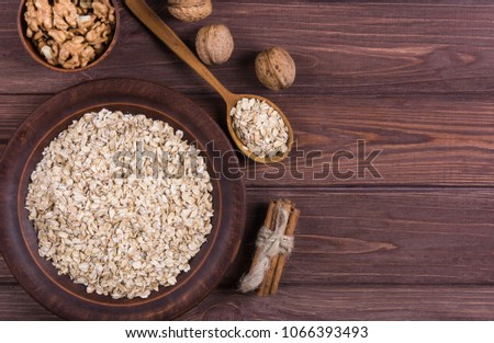 Raw oatmeal with ingredients walnut and cinnamon #1066393493