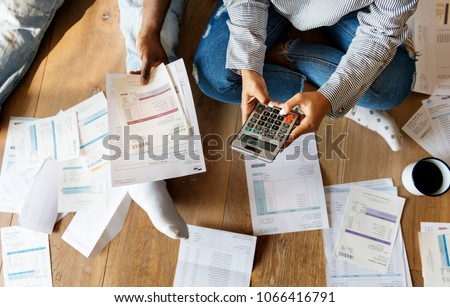 Couple managing the debt #1066416791