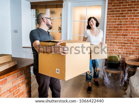 Couple moving into new house #1066422440
