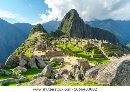 Machu Picchu, the most familiar icon of Inca civilization situated on a mountain ridge above the Sacred Valley northwest of Cuzco, Cusco Region, Peru. #1066483802