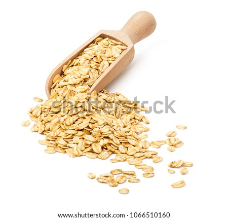 Oatmeal flakes in wooden scoop isolated on white background. Rolled oats for package design #1066510160