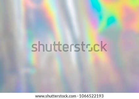 Blurry abstract pastel iridescent holographic foil background Royalty-Free Stock Photo #1066522193