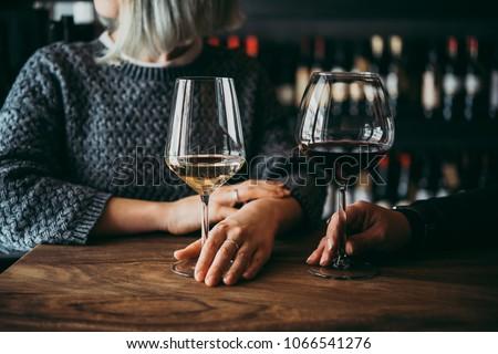 Young women enjoying their wine in a bar #1066541276