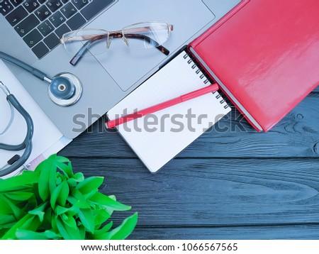 stethoscope laptop desktop top view black wooden  #1066567565