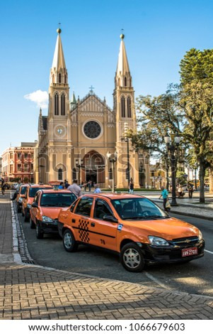 Curitiba, Brazil, January 03, 2018. Taxi drivers chat while wait passengers in front of Cathedral Basilica of Curitiba in the central region of Curitiba city, in Parana State #1066679603