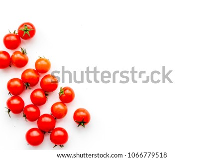 Fresh red cherry tomatoes scattered on white background top view copy space #1066779518