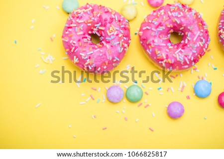 Pink Donut with sprinkles on yellow background  #1066825817