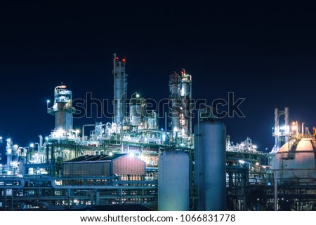 Manufacturing of petroleum industrial plant with gas tanks at night #1066831778