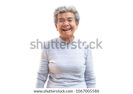 Happy Asian old woman smiling and joyful on white background #1067005586