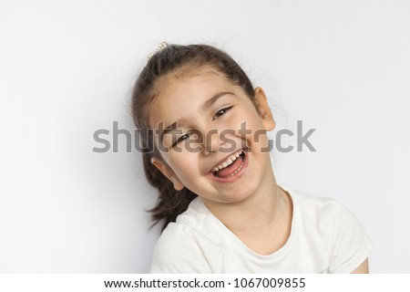 Portrait of a happy laughing child girl