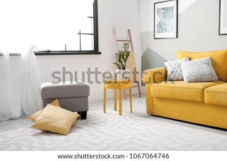 Stylish living room interior with comfortable sofa #1067064746